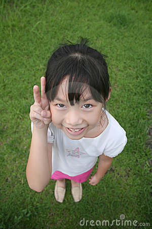 Girl looking upward with victory sign