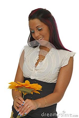 Girl looking yellow flower