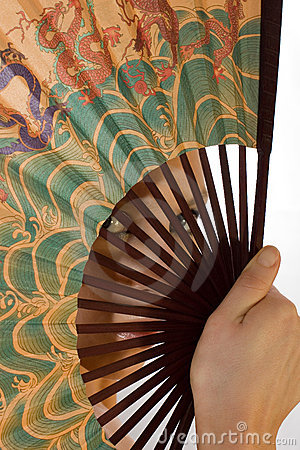 Girl looks through a Chinese fan