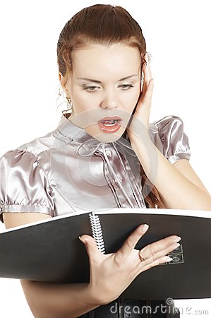 Girl Looks In A Folder With The Documents And Is A Stock Image - Image: 7789361