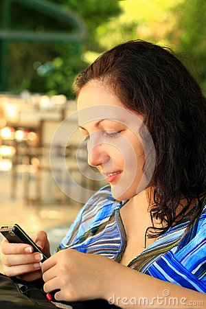 Girl looks at mobile phone
