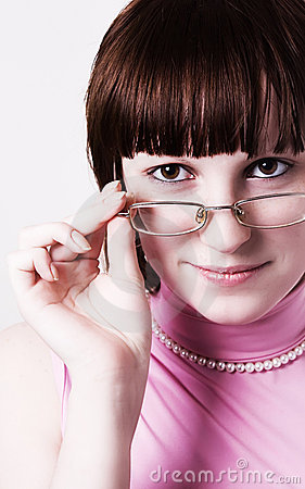 The girl looks over glasses