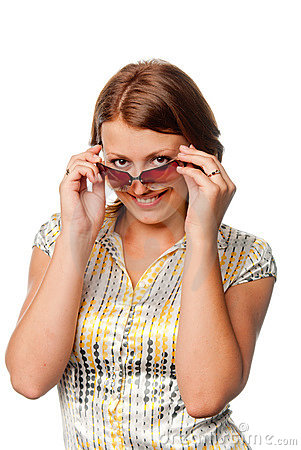 Girl looks over spectacles