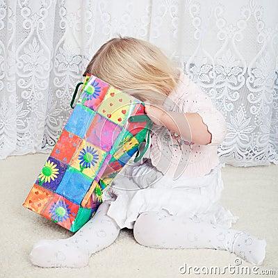 Girl looks in the shopping bag