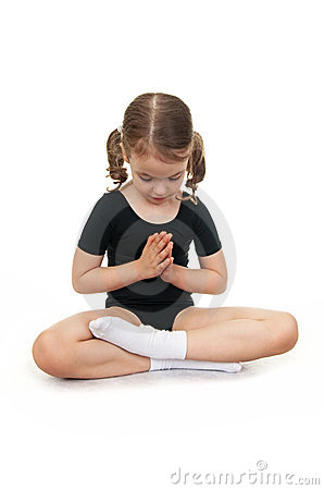 Girl in the lotus position. Children s yoga.