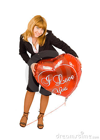 A girl with a love sign - heart balloon