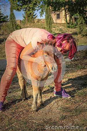 Woman with farm pony