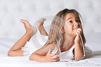 Girl lying barefoot