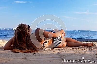 Girl lying on a beach