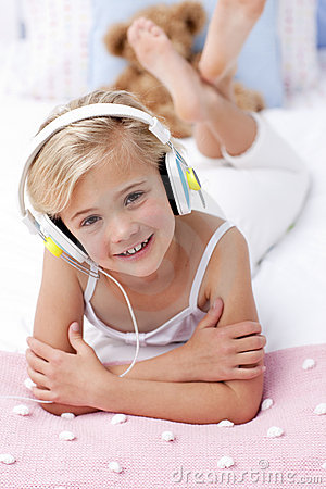 Girl lying in bed listening to the music