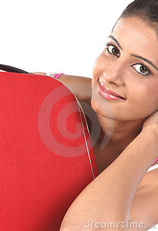 Girl lying behind the red suitcase