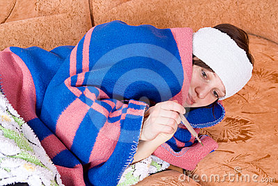 Girl lying on the couch sick