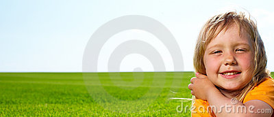 Girl lying in field