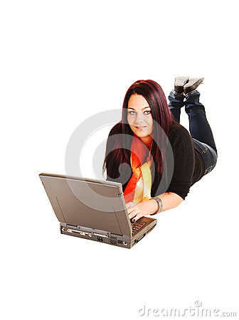 Girl lying on floor with laptop.