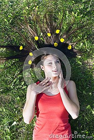Girl lying on the grass flatten your hair