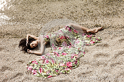 Girl lying on the sand