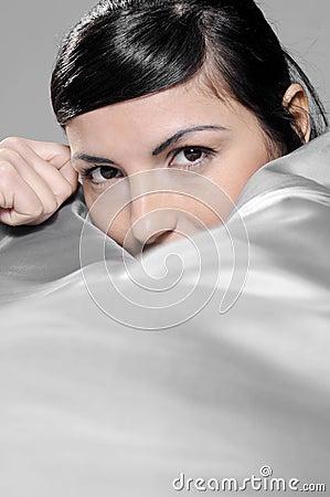Girl lying on silver silk