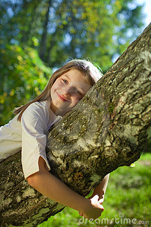 Girl lying on a tree