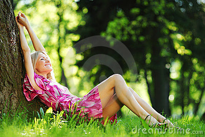 Girl lying under a tree
