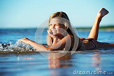 Girl lying in the water