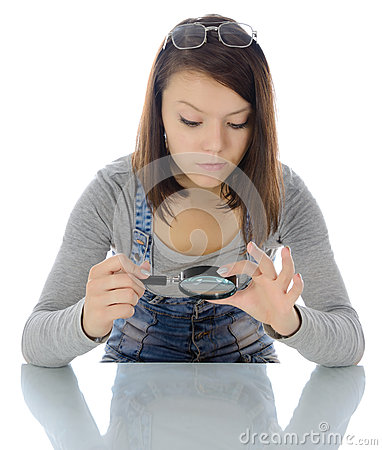 Girl with magnifying glass.
