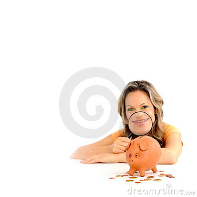 Girl with magnifying glass and piggy bank