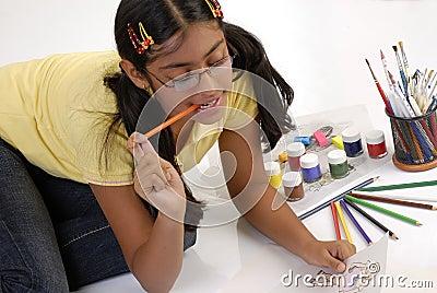 Girl makes fashion sketch