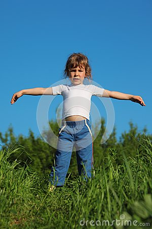 Girl makes gymnastic in grass