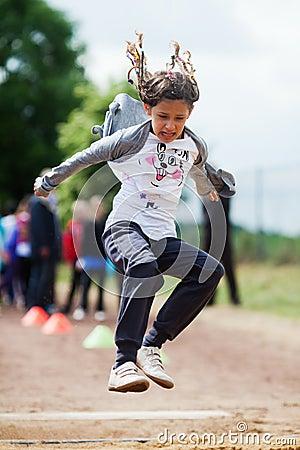 Girl makes long jump
