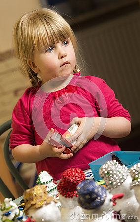 Girl making Christmas decorations