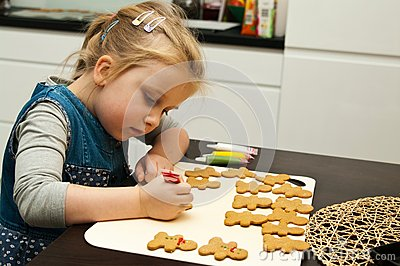 Girl making gingerbread cookies for Christmas Stock Photo