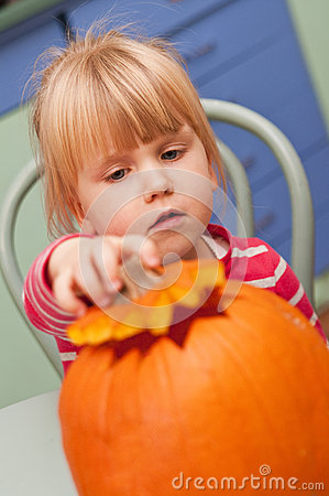 Girl making halloween pumpkin