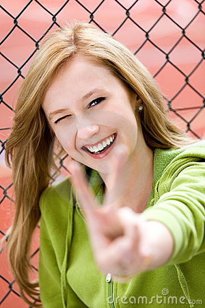 Free Girl Making Peace Sign Royalty Free Stock Image - 20576116