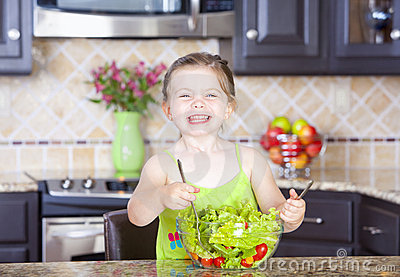 Girl making salad