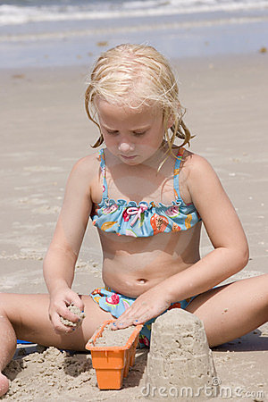 Girl Making Sand Castles at Beach