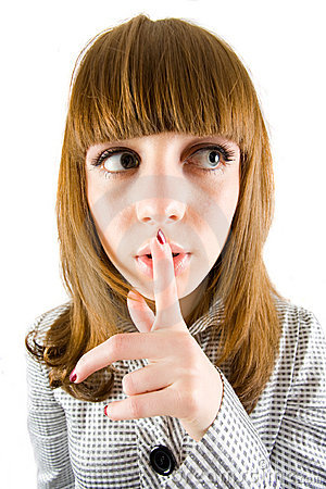 Girl making silence sign