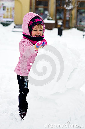 Girl making snowman