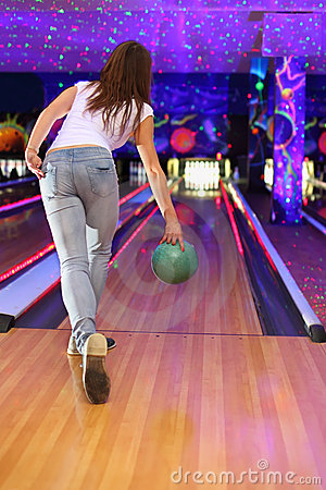 Free Girl Making Throw Of Ball In Bowling Club Royalty Free Stock Photo - 22736075