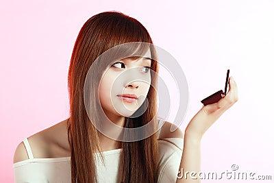 Girl making up.