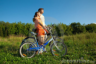 Girl and man with bicycles embrace each other