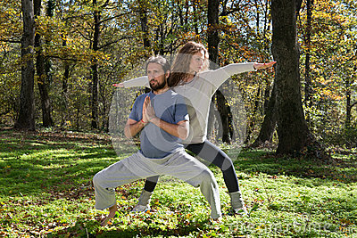 Girl and man doing yoga meditation