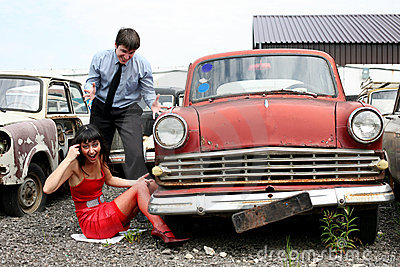 Girl and man beside retro car