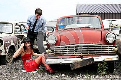 Girl and man beside retro car