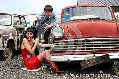 Girl and man at retro car
