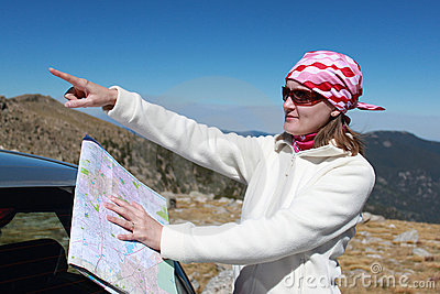 Girl with map trying to locate the route
