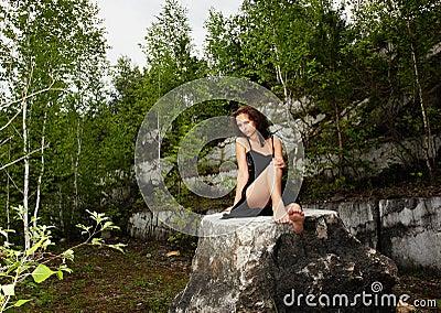 Girl in marble open-cast mine
