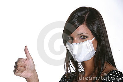 Girl with mask against swine flu.