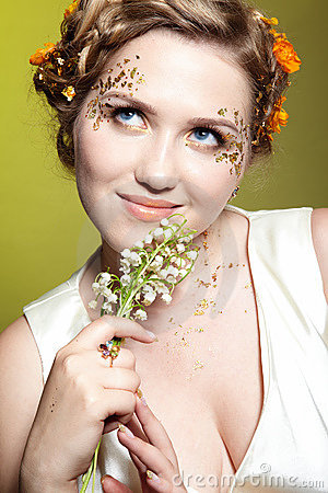 Girl with may lily flowers
