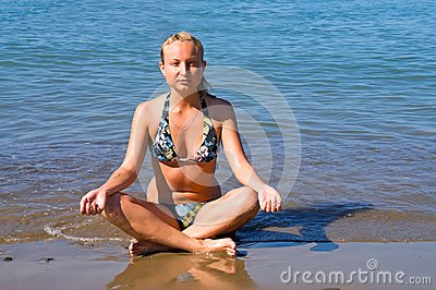 Girl meditates in lotus position