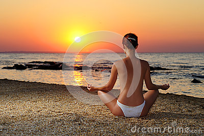 Girl meditating in sunrise